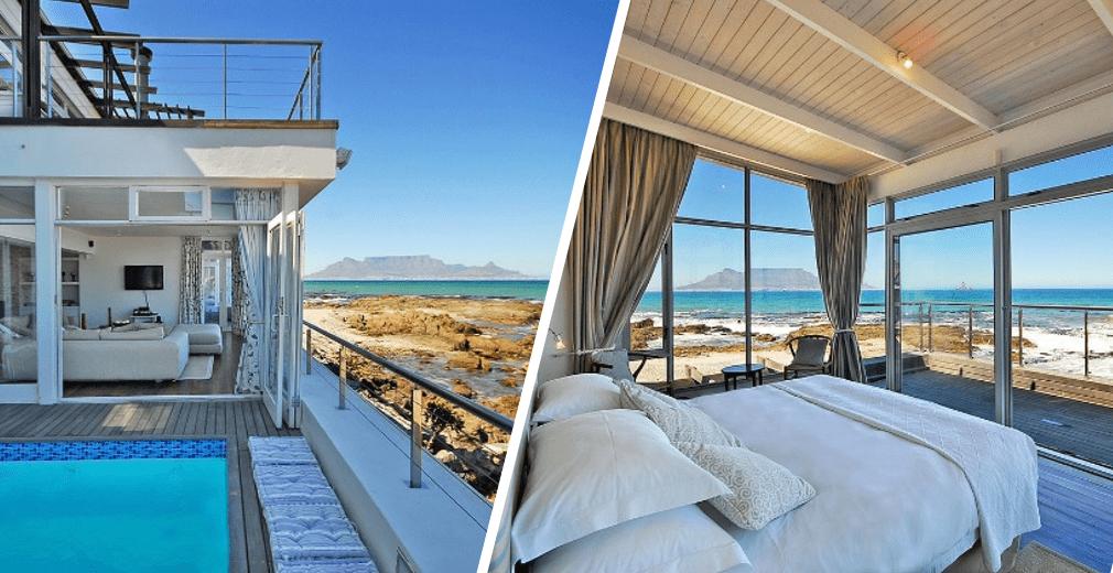Maison de plage et sa chambre disposant d'une vue sur table mountain